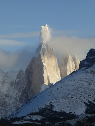 Cerro Torre appears from the clouds